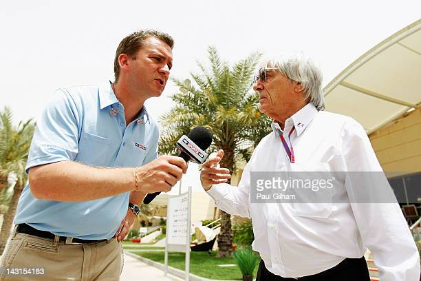 F1 supremo Bernie Ecclestone is interviewed by Craig Slater of Sky Sports News as he walks in the paddock during practice for the Bahrain Formula One...