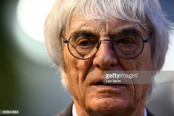 Supremo Bernie Ecclestone looks on in the paddock during previews ahead of the Singapore Formula One Grand Prix at Marina Bay Street Circuit on...