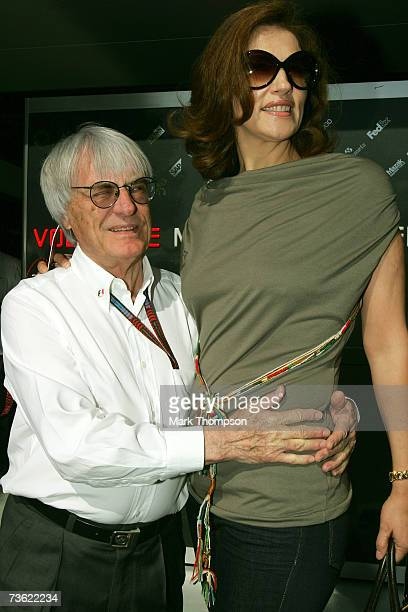 Supremo Bernie Ecclestone poses with his wife Slavica Ecclestone in front of photographers at the Australian Grand Prix Corporation Chairman Ron...