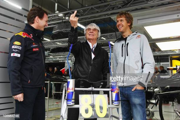 F1 supremo Bernie Ecclestone reacts as Christian Horner Sebastian Vettel and the Red Bull Racing team present him with a specially made zimmer frame...