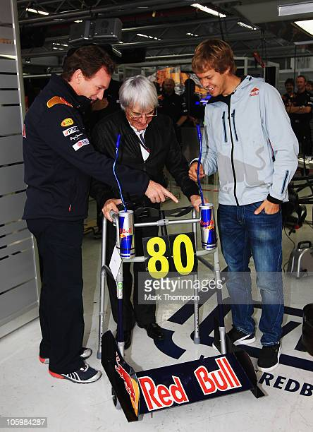 Supremo Bernie Ecclestone shares a joke with Christian Horner , Sebastian Vettel and the Red Bull Racing team as they present him with a specially...