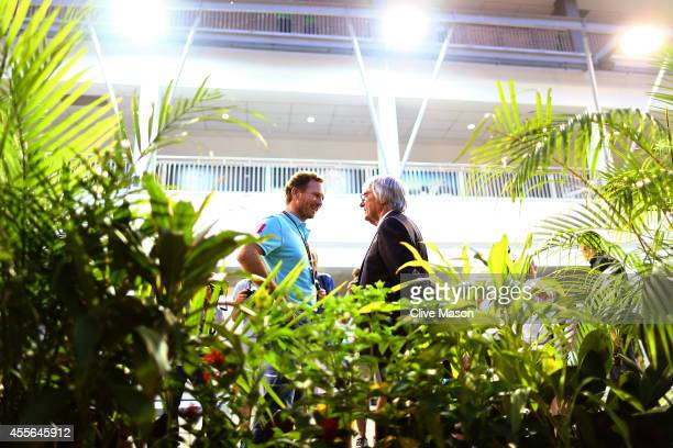 Supremo Bernie Ecclestone speaks with Infiniti Red Bull Racing Team Principal Christian Horner in the paddock during previews ahead of the Singapore...