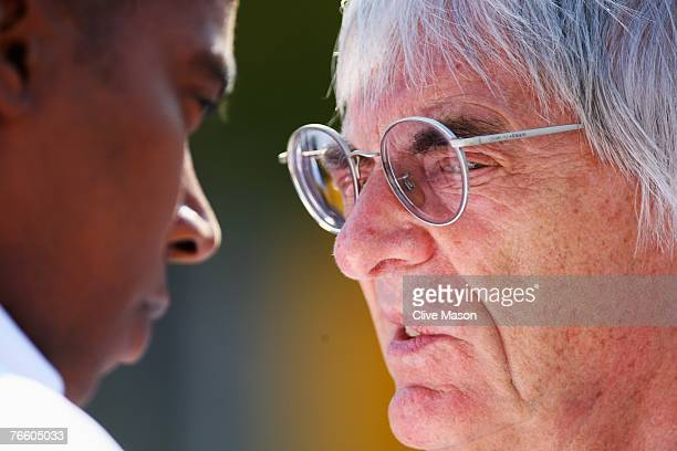 F1 supremo Bernie Ecclestone talks with Anthony Hamilton father of Lewis Hamilton of Great Britain and Mclaren Mercedes in the paddock before the...