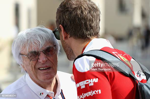 F1 supremo Bernie Ecclestone talks with Sebastian Vettel of Germany and Ferrari before practice for the Abu Dhabi Formula One Grand Prix at Yas...