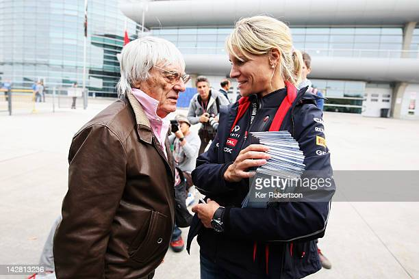 F1 supremo Bernie Ecclestone talks with Sebastian Vettels personal assistant Britta Roeske in the paddock during previews to the Chinese Formula One...