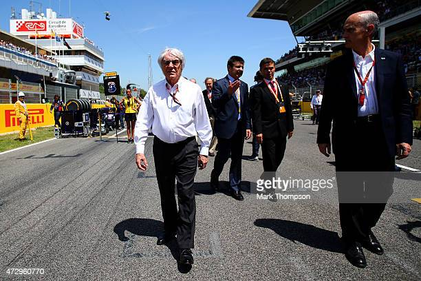 F1 supremo Bernie Ecclestone walks on the grid before the Spanish Formula One Grand Prix at Circuit de Catalunya on May 10 2015 in Montmelo Spain