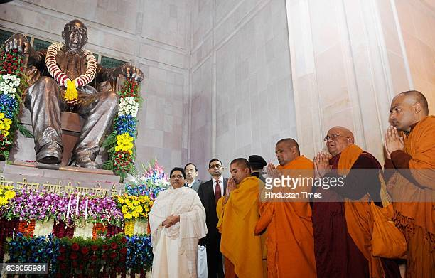 Supremo Mayavati paying homage to the statue of Dr Bhimrao Ambedkar on his 61st death annivarsary here at Ambedkar memorial on December 6 2016 in...