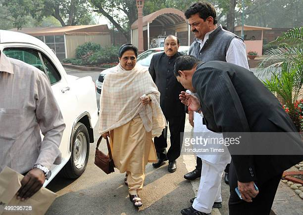 BSP supremo Mayawati greeted by party MPs as she arrives during the winter session of Parliament on November 30 2015 in New Delhi India The Lok Sabha...