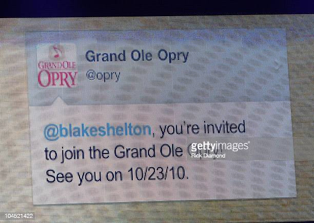 Suprise 'Tweet' from Grand Ole Opry handed to Recording Artist Blake Shelton from Recording Artist Trace Adkins after their preformance during...