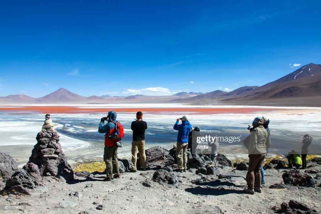 Sur Lipez or Sud Lipez Province, Altiplano of Bolivia, 2011: tourists in the Eduardo Avaroa Andean Fauna National Reserve, Laguna Colorada.