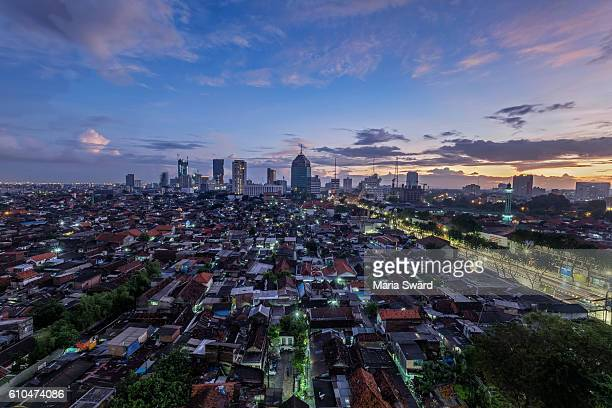 surabaya - skyline at blue hour/sunrise - surabaya stock pictures, royalty-free photos & images