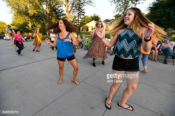 Surai Quimby and her daughter Mikayla Quimby dance during dance class held by her father Schukr 'Sugar' Basanow a Mongolianborn former Broadway...