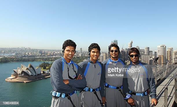 Suraj Kaluhalamulla Dinesh Chandimal Kumar Sangakkara and Jeevan Mendis of Sri Lanka pose as they climb the Sydney Harbour Bridge during a...