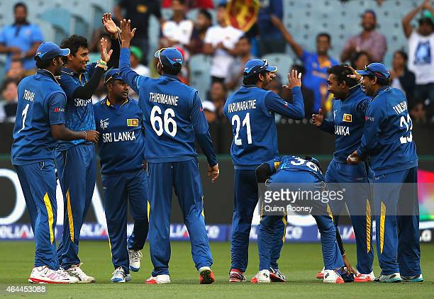 Suranga Lakmal of Sri Lanka is congratulated by team mates after getting the wicket of Mominul Haque of Bangladesh during the 2015 ICC Cricket World...