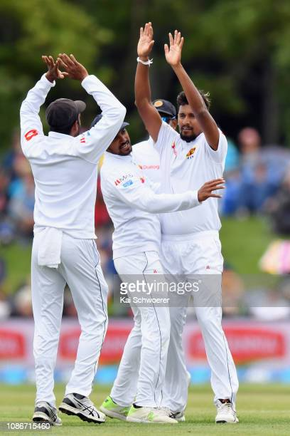 Suranga Lakmal of Sri Lanka is congratulated by team mates after dismissing Tom Latham of New Zealand during day one of the Second Test match in the...