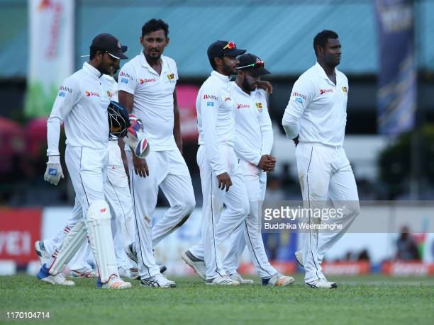 Suranga Lakmal of Sri Lanka with his team mates leaves the field end of day four of Second Test match between Sri Lanka and New Zealand at...