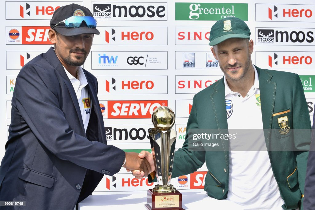 Suranga Lakmal (L) Sri Lankan captain and Fuf Du Plessis (R) South African captain unveiling the Test series trophy before day 1 of the 1st Test match between Sri Lanka and South Africa at Galle International Stadium on July 12, 2018 in Galle, Sri Lanka.