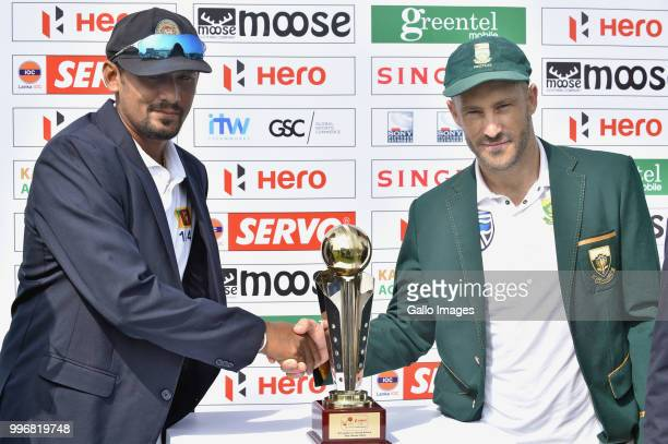 Suranga Lakmal Sri Lankan captain and Fuf Du Plessis South African captain unveiling the Test series trophy before day 1 of the 1st Test match...