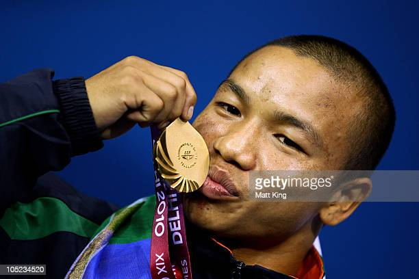 Suranjoy Mayengbam of India poses with the gold medal during the medal ceremony for the Fly Weight Men Finals Gold Medal Bout at Talkatora Indoor...
