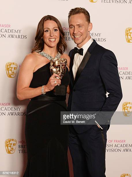 Suranne Jones winner of the Leading Actress award for 'Doctor Foster' and presenter Tom Hiddleston pose in the winners room at the House Of Fraser...