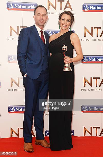 Suranne Jones with the award for Drama Performance and her husband Laurence Akers during the 21st National Television Awards at The O2 Arena on...
