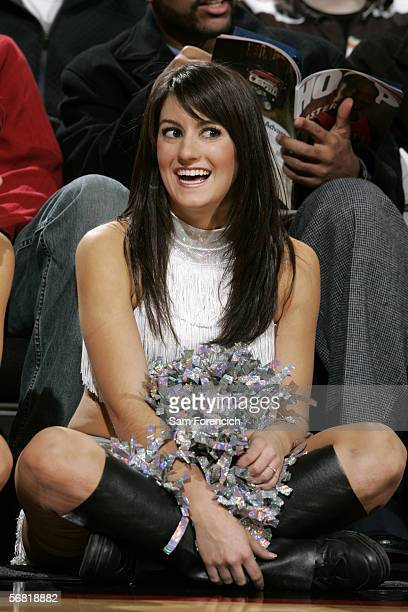 Suraya of the Portland BlazerDancers smiles while sitting on the sidelines during the game against the Denver Nuggets on January 25 2006 at the Rose...