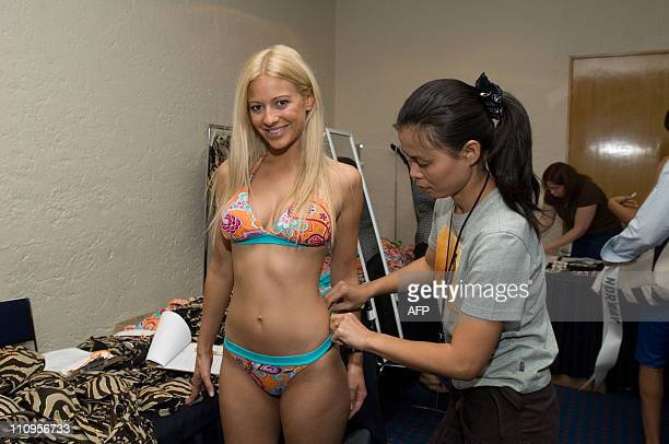 Sureerat Polyiam helps Christa Rigozzi Miss Switzerland 2007 choose a BSC Swimwear Thailand swimsuit during registration and fittings for the Miss...