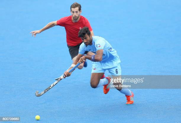 Surender Kumar of India is put under pressure by Iain Smythe of Canada during the 5th/6th place match between India and Canada on day nine of the...