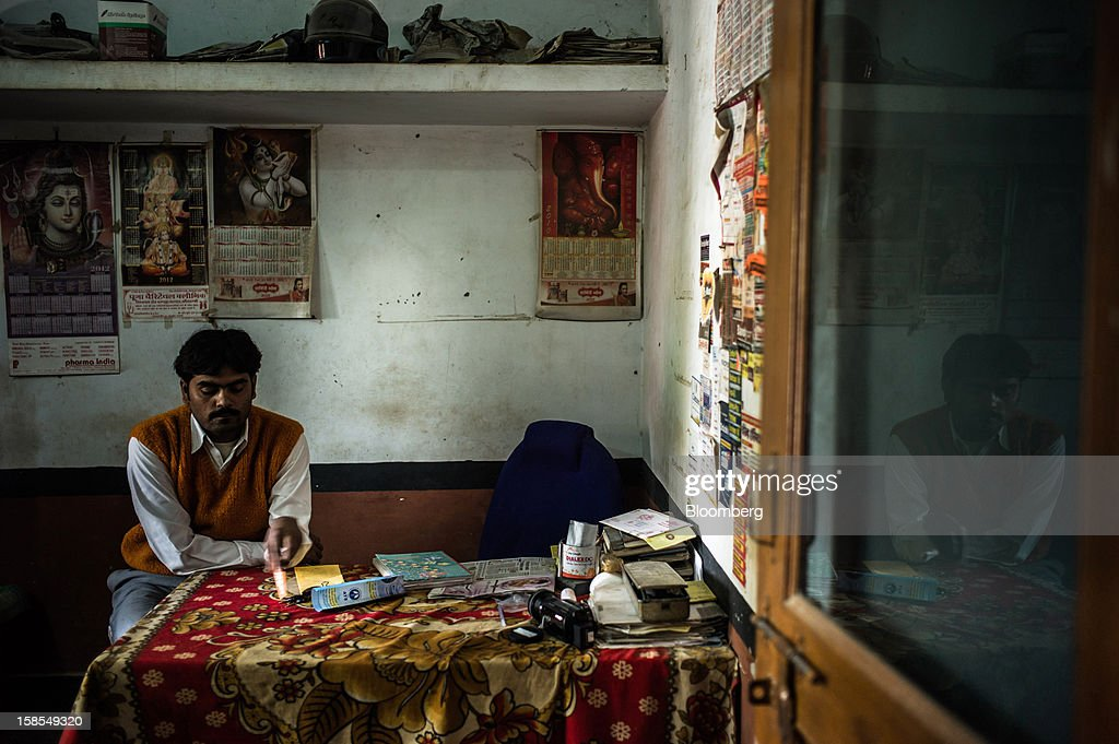 Suresh Kumar sits in a clinic he runs near the village of Paltupur, Uttar Pradesh, India, on Friday, Dec. 7, 2012. India has the highest percentage of malnourished children in the world except for East Timor, according to the 2012 annual Global Hunger Index. Photographer: Sanjit Das/Bloomberg via Getty Images