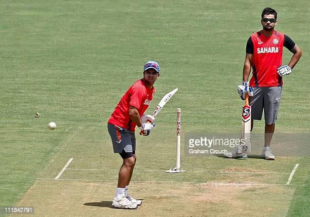 Suresh Raina and Virat Kohli of India training at Wankhede Stadium ahead of tomorrow's final between India and Sri Lanka on April 1 2011 in Mumbai...