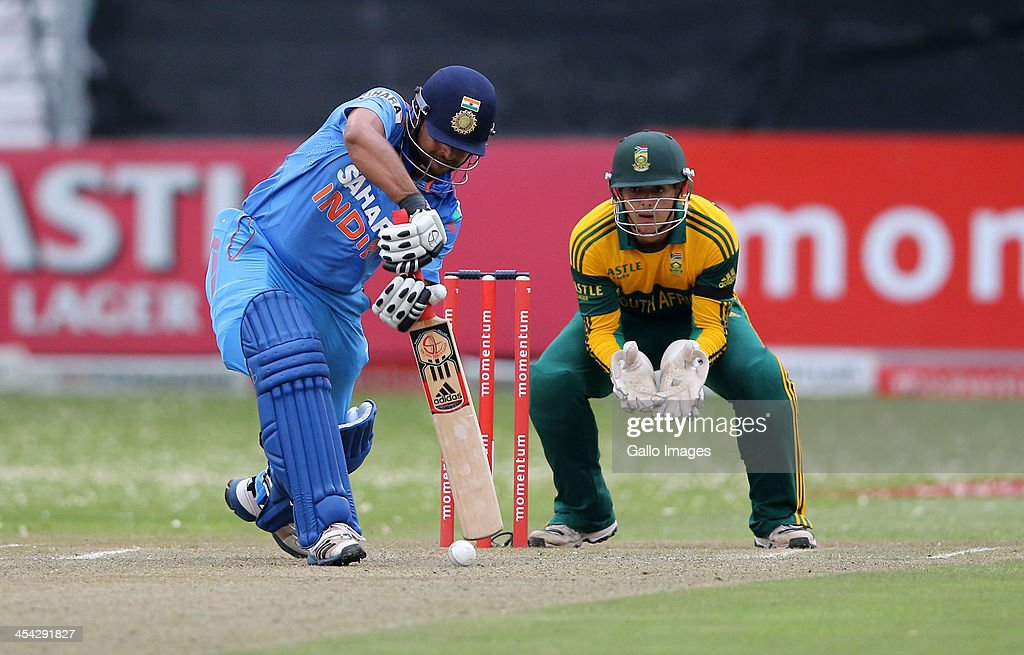 Suresh Raina bats during the 2nd Momentum ODI match between South Africa and India at Sahara Stadium Kingsmead on December 08, 2013 in Durban, South Africa.