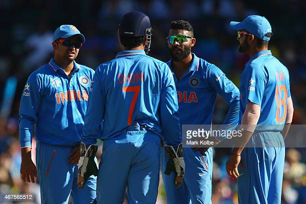 Suresh Raina MS Dhoni Ravindra Jadeja and Virat Kohli of India discuss whether to call for the DRS referral after an LBW shout against Aaron Finch of...