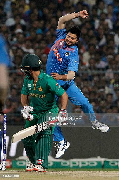 Suresh Raina jumps to try and catch a shot by Ahmed Shehzad of Pakistan during the ICC World Twenty20 India 2016 match between Pakistan and India at...