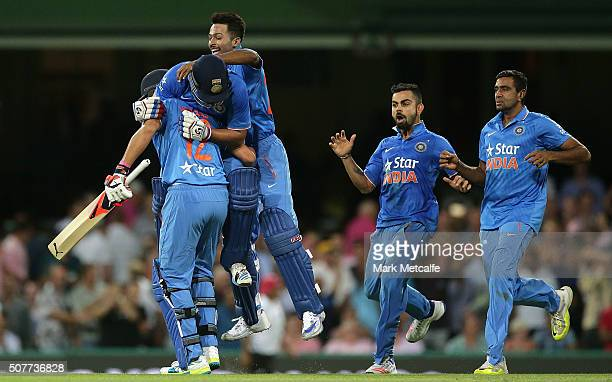 Suresh Raina of India and Yuvraj Singh of India celebrate victory with team mates in the International Twenty20 match between Australia and India at...