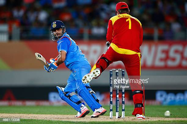 Suresh Raina of India bats during the 2015 ICC Cricket World Cup match between India and Zimbabwe at Eden Park on March 14 2015 in Auckland New...
