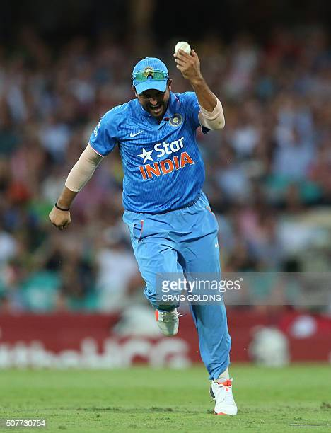 Suresh Raina of India catches Glenn Maxwell of Australia off the bowling of Yuvraj Singh during the third Twenty20 international cricket match...