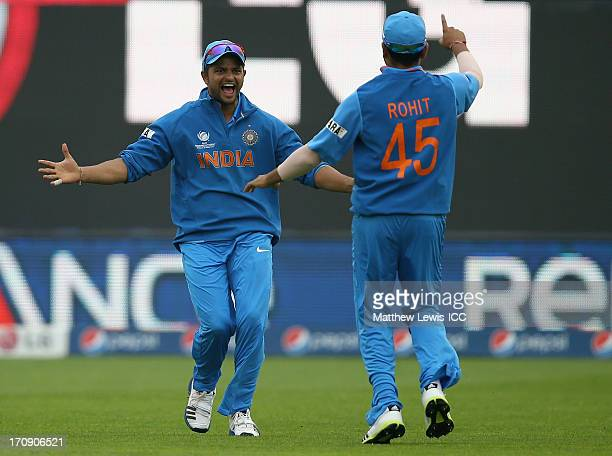 Suresh Raina of India celebrates catching Kusal Perera of Sri Lanka with Rohit Sharma during the ICC Champions Trophy Semi Final match between India...