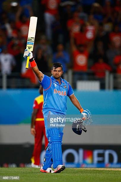 Suresh Raina of India celebrates his century during the 2015 ICC Cricket World Cup match between India and Zimbabwe at Eden Park on March 14 2015 in...