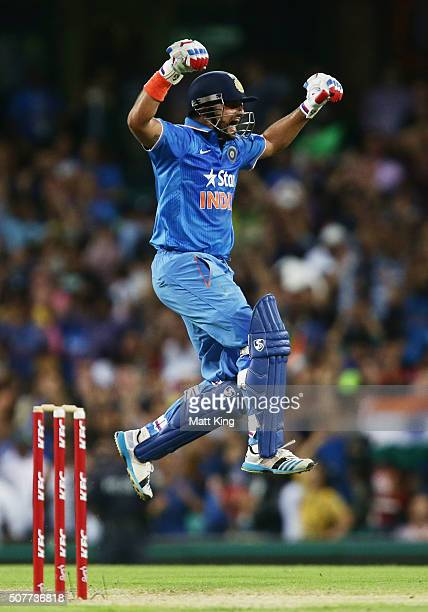 Suresh Raina of India celebrates hitting the winning runs on the last ball of the match during the International Twenty20 match between Australia and...