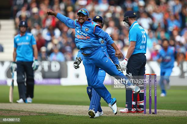 Suresh Raina of India celebrates taking a catch to dismiss Ben Stokes of England off the bowling of Ravichandran Ashwin during the third Royal London...