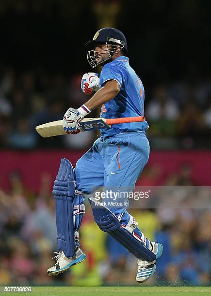 Suresh Raina of India celebrates victory in the International Twenty20 match between Australia and India at Sydney Cricket Ground on January 31 2016...
