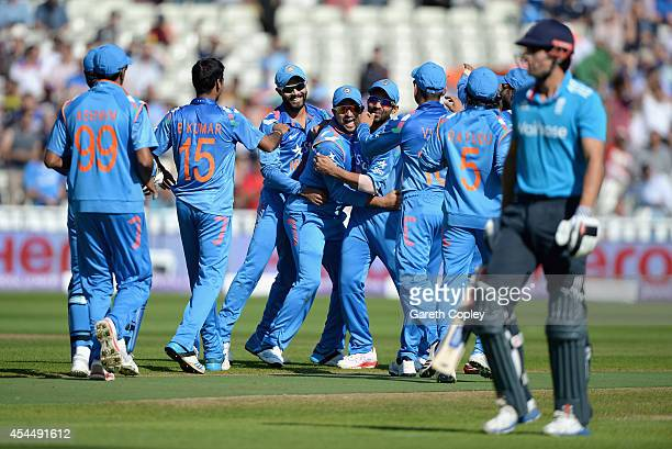 Suresh Raina of India celebrates with teammates after catching out England captain Alastair Cook during the 4th Royal London One Day International...