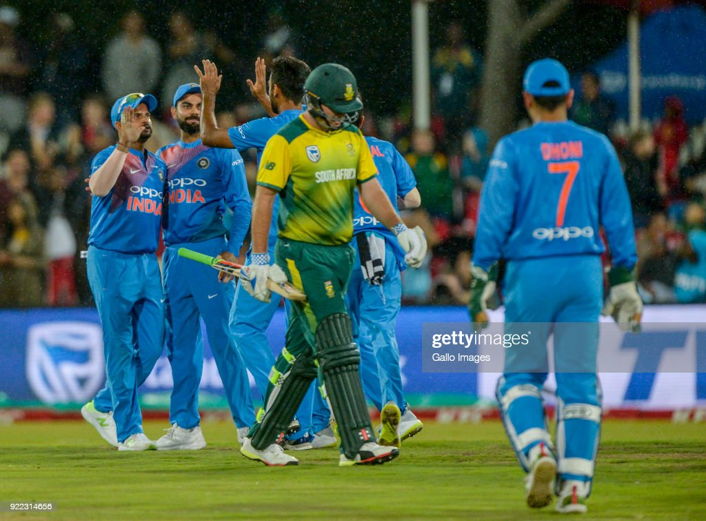Suresh Raina of India celebrates with teammates after the dismissal of Jon Jon Smuts of South Africa during the 2nd KFC T20 International match between South Africa and India at SuperSport Park on February 21, 2018 in Pretoria, South Africa.