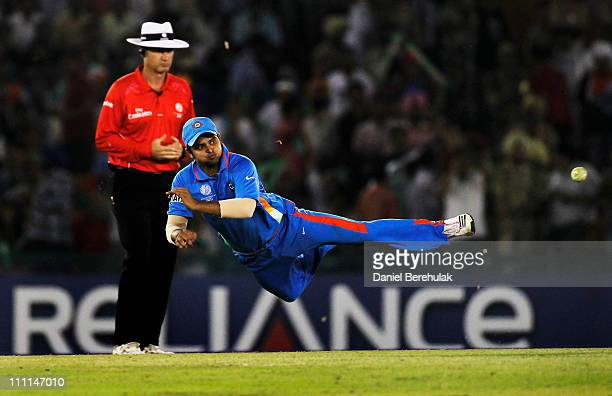 Suresh Raina of India fields during the 2011 ICC World Cup second SemiFinal between India and Pakistan at Punjab Cricket Association Stadium on March...