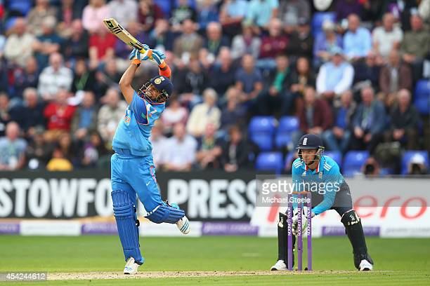 Suresh Raina of India hits a straight six off the bowling of James Tredwell as wicketkeeper Jos Buttler looks on during the second Royal London...