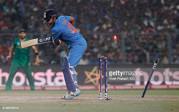 Suresh Raina of India is bowled by Mohammad Sami of Pakistan during the ICC World Twenty20 India 2016 match between Pakistan and India at Eden...