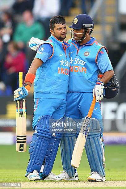 Suresh Raina of India is congratulated by capatin MS Dhoni after reaching his century during the second Royal London OneDay Series match between...