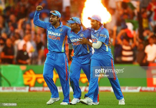 Suresh Raina of India is congratulated by tem mates after catching David Warner of Australia during the International Twenty20 match between...