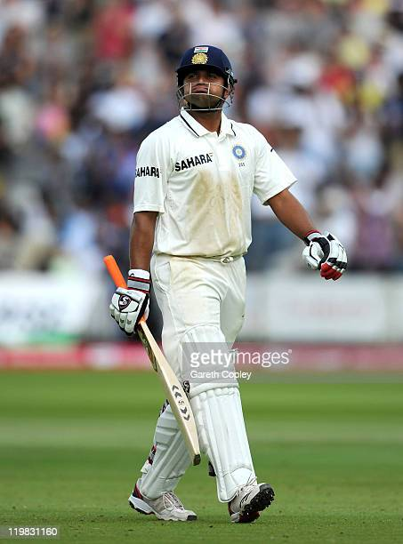 Suresh Raina of India leaves the field after being dismissed by James Anderson of England during day five of the 1st npower test match between...