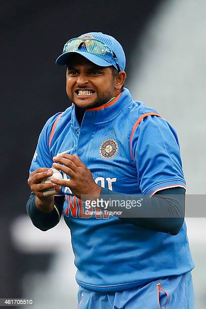 Suresh Raina of India reacts after taking a catch to dismiss David Warner of Australia during the One Day International match between Australia and...